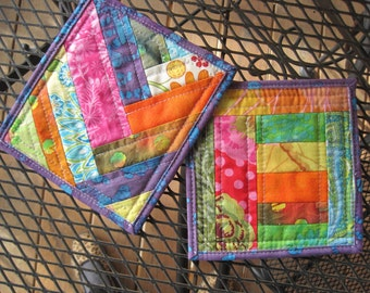 Set of two pot holders. Scrappy, handmade, quilted, and reversible.