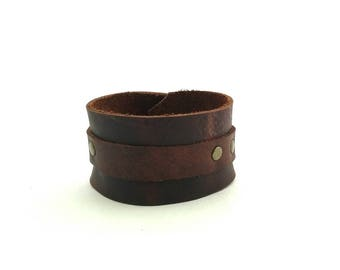 Men's leather cuff with antique brass studs