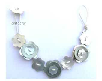 Bracelet button jewelry made of flower shell buttons on silver color leather cord