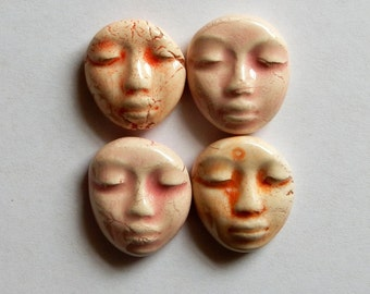 four light colored faces...peach and pink
