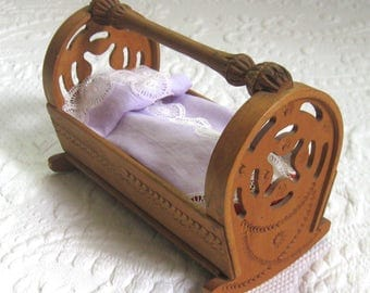 doll cradle . carved doll cradle .  hand carved doll cradle . made in Yugoslavia