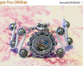 SALE 25% OFF - Steampunk Jewelry - Bracelet - antique watch movement and dark aqua swarovski crystal - Silver tone