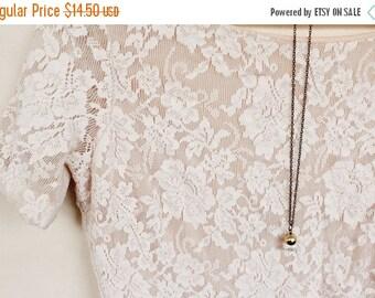 Sale Tiny crystal acorn necklace.