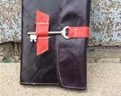 Refillable purple and red leather journal with skeleton key