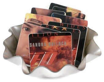 Speed wood coasters and warped laser disc basket from recycled movie album