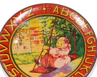 """1920s Tin Litho Toy Tea Plate, Girl on a Swing with alphabet, by Ohio Art Co. Small size, 3.5"""""""