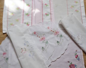 collection of embroidered rose themed mats