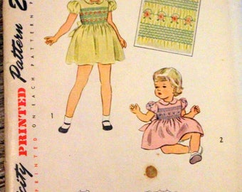 Another rare find!  Vintag Simplicity Sewing Pattern #1842; ©1946; Child's size 1 dress with smocking; UNCUT AND COMPLETE.