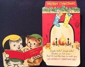 Adorable UNUSED Vintage Mid-Century Die Cut Christmas Greeting Card Anthropomorphic Puppy and Bear Singing Carols w/ Fireplace