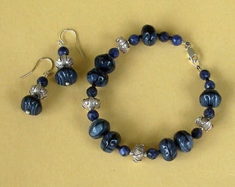 Blue and Black Striped Czech Glass Puffed Disk Beads Bracelet with Hill Tribe Silver Beads by Carol Wilson of Je t'adorn