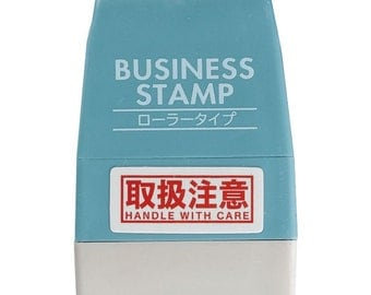 roller business stamp - handle with care - red