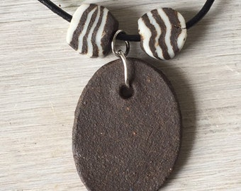 1 Ceramic Pottery  brown oval  necklace with flanking striped beads