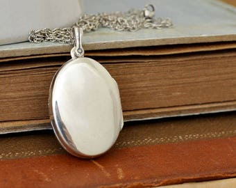large oval sterling silver locket necklace. simple everyday wear. photo locket.