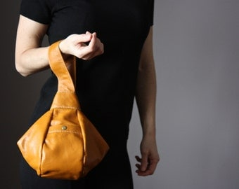 Modern Japanese knot wrislet , leather clutch, casual style clutch, knot style bag , everyday women accessories
