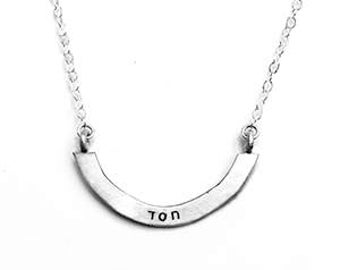 chesed/lovingkindness — double-sided stamped silver arc necklace