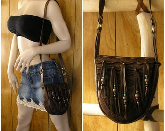 "Leather purse, brown, black & gold lambskin with sculpted leather, beaded fringe with copper and teal beads, 23"" x 1"" strap, inside pocket"