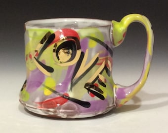 Colors of love mug with gold