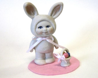 "Bunny 2"" handcrafted in porcelain with basket of eggs"