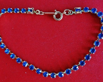 """Unsigned AVON Vintage gold tone 7.25 """" bracelet with cobalt blue rhinestones in great condition, appears unworn"""