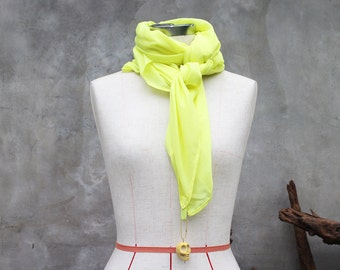 Chartreuse yellow weighted scarf with large yellow howlite skull charm