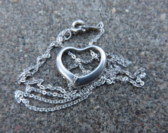 Vintage delicate Sterling chain with a Sterling floating heart charm