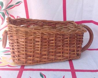 Vintage wicker wine serving storage basket.