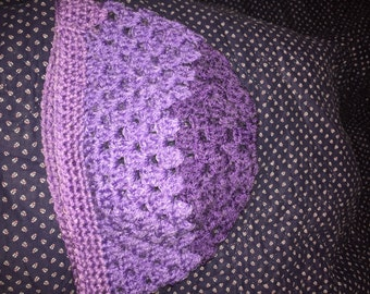 Crocheted purple striped ponytail/bun beanie