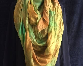 This is a double layered silk triangle scarf, hand dyed and nuno felted merino wool