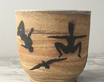 Flying art cup silhouette painting teacup marbled stoneware vessel skateboarder yogi jumping woman backflip bird