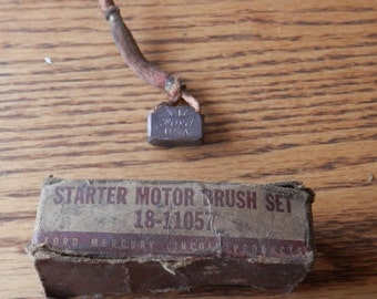 antique Ford Motor Co parts box with 1 starter motor brush 18-11657