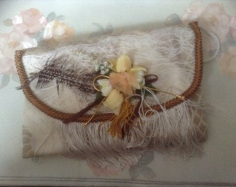 Victorian tan  purse with feather and with rope handle