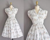 vintage 1950s dress. 50s novelty white cotton horse carriage dress