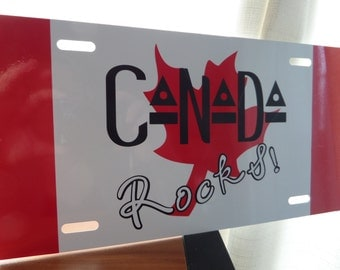 CANADA ROCKS! Front License Plate; metal, Show your Canadian Pride! Weatherproof Vinyl Canada License Plate; Free Shipping
