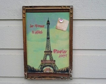 Paris Eiffel Tower Magnet Board, blue green and gold image printed on to fabric over sheet metal in a gold vintage frame