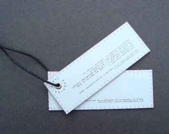 Polite minimalist leather luggage tag set with ultimate privacy (it does like to talk to strangers..)