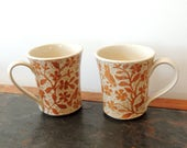 Two Mugs, Hand Carved with Birds and Flowers, Rusty Brown and White