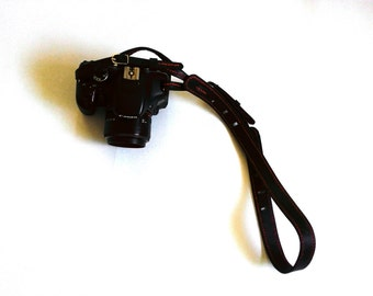 Black stitched on black leather, camera neck strap