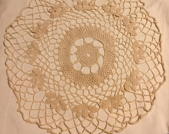 A vintage, hand crocheted/ lace made doily.