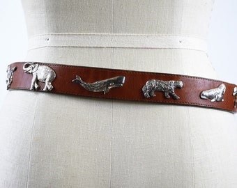 Early 90s Brown Leather Belt with Brass Buckle and Wild Animals Zebra Rhinocerous Sea Turtle Elephant Bear Walrus Whale Big Cat