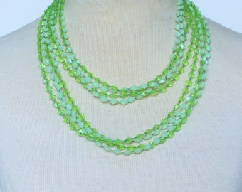 Vintage 70s Multi Four Strand Bright Lime Green Opaque and Clear Long Flapper Rope Length Multistrand Plastic Beaded Necklace