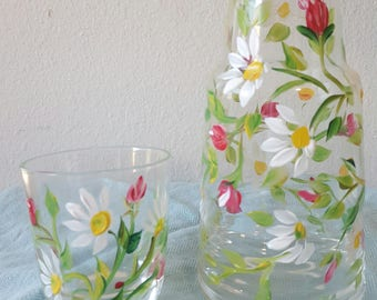 Bedside carafe reserved for customer, daisies and roses.