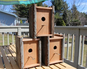 Reclaimed wood bird houses with skeleton key perches.