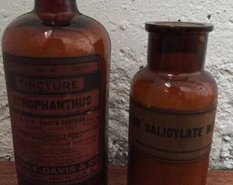 Two Vintage Medicine Apothecary Bottles