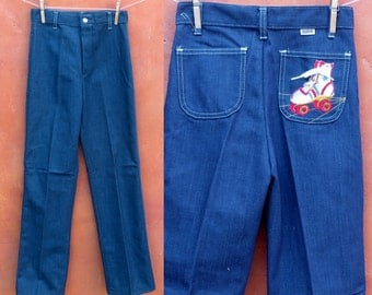 Vintage  1970s 1980s Girl's Toughskins Blue Denim Jeans with lace up / tie roller skate patch on back pocket. high waisted deadstock 14 SLIM