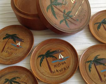 Aloha Hawaii Coasters.  6 Vintage Carved and Painted Wood Coasters and Holder.   Mid century, Eames era.  Vintage 1960.  Made in Japan.