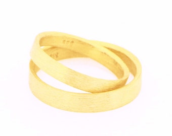 Wedding band rings set in 14 k gold certified fairmined matt gold inside and out brushed finishing gold to be proud of sustainable wedding