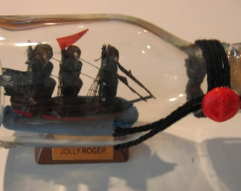 """Pirate Ship in a Bottle--JOLLY ROGER Three Masted 4 1/2"""" long"""