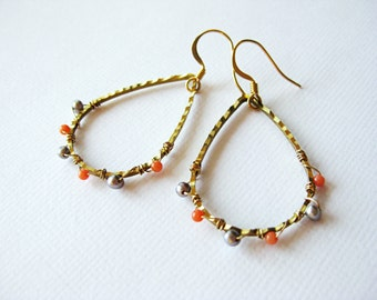 Tear shaped hoop earrings in gold, with small orange coral beads and grey pearls
