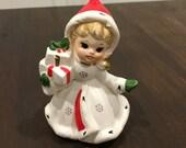 Christmas  Napco girl holding a christmas present napcoware