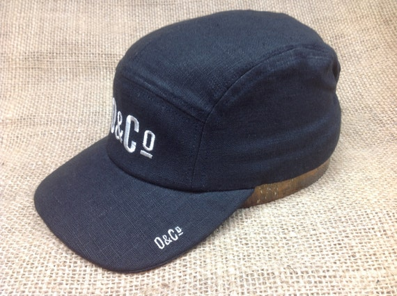 Put your own Custom logo on our caps, hand made in USA using European black linen 5 panel caps.